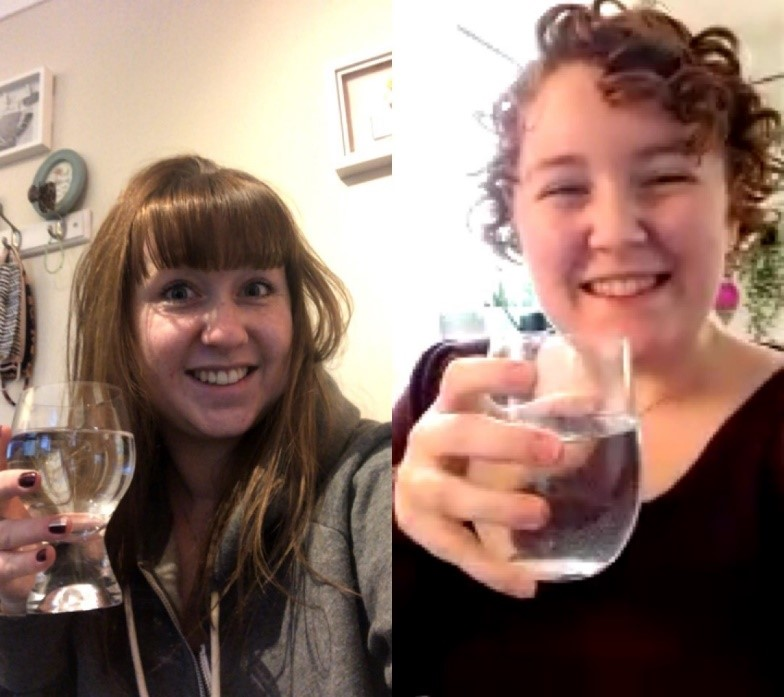 Charlotte and Vickie holding glasses of water cheering to finishing Dry 2020