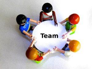 Team sat round a table