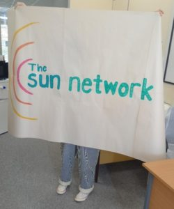 poster with big sun network logo